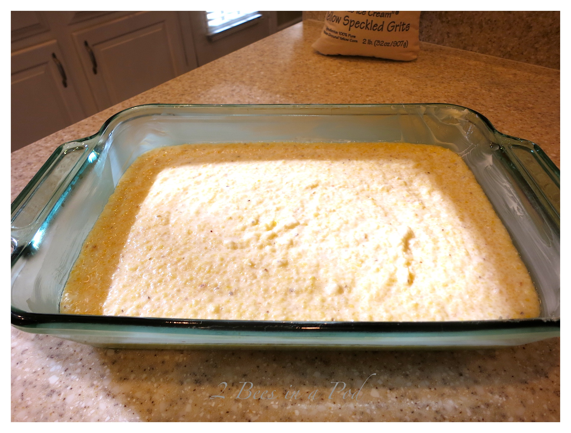 """Decadent parmesan cheese grits. The speckled yellow grits from Nora Mill Granary are known as """"Dixie Ice Cream"""". Cooked on water and half and half make these grits super creamy."""