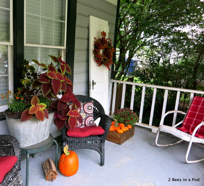 Fall Front Porch decor with mums, pumpkins, galvanized planter, hanging baskets, kale, wreath, vintage door, rustic birdhouse
