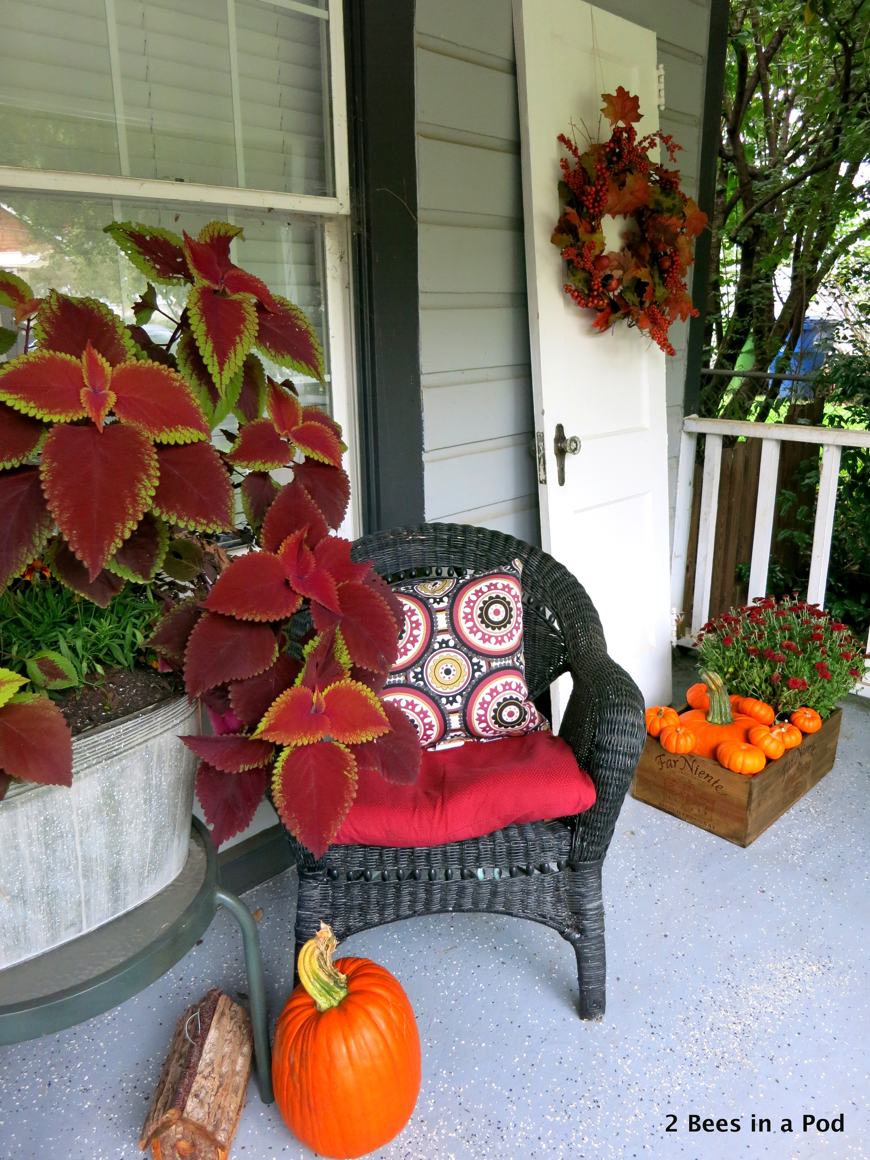 Fall Front Porch decor with mums, pumpkins, galvanized planter, hanging baskets, kale, wreath, vintage door, rustic birdhouse