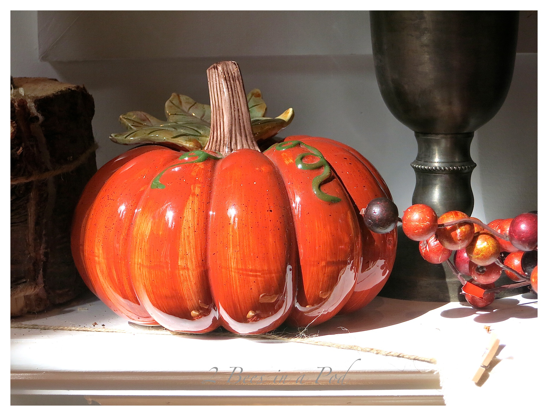 Fall Mantle Decor...Bloggers Fall Tour.  Mantle decorated with vintage and rustic items. Muted colors for Fall. Natural gourds, vintage trophies and loving cup, vintage suitcase, vintage wicker wine bottle, rustic ladders.