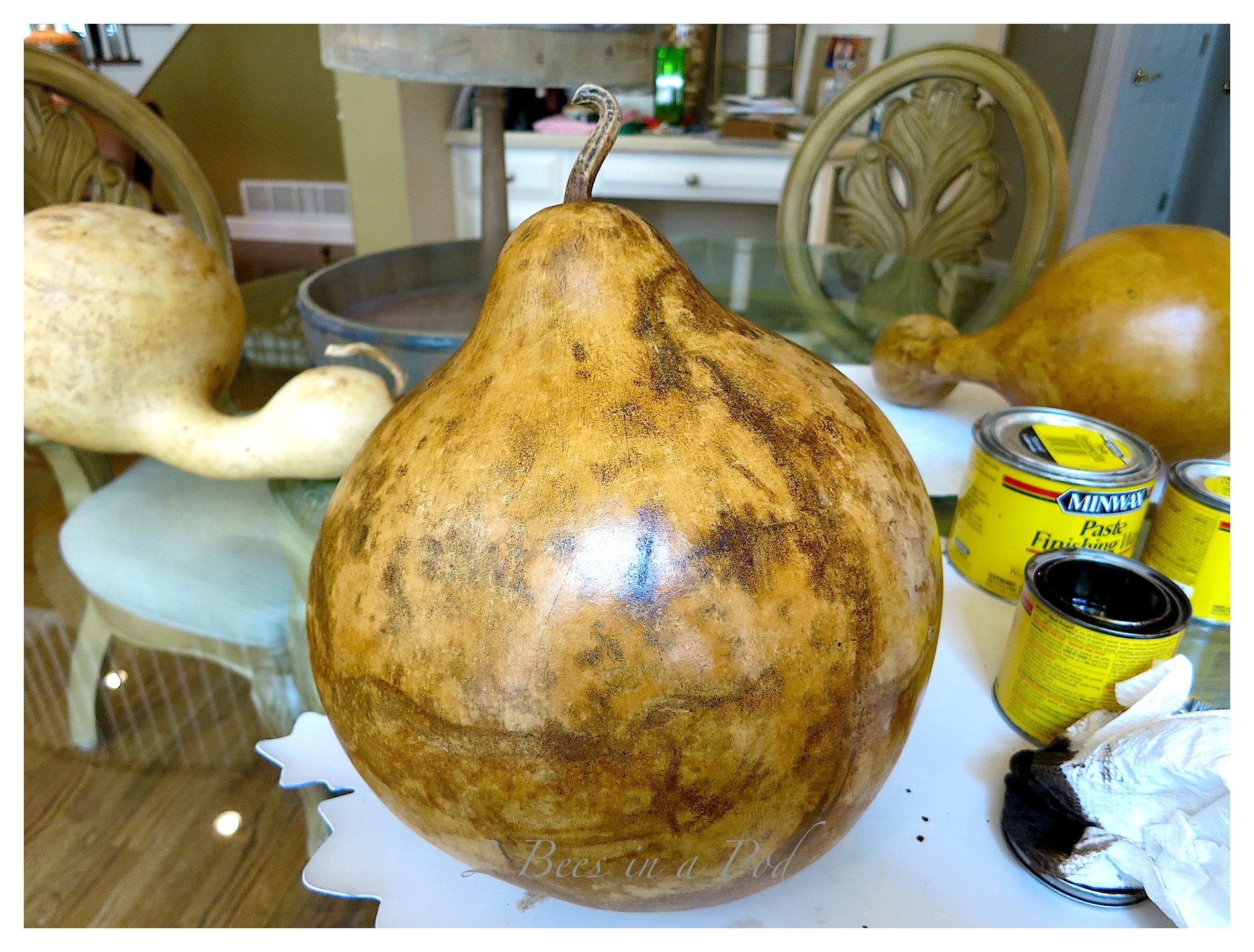 Apply paste wax onto the gourd to protect the coat and give it more shine. The stain will be dry in about an hour.