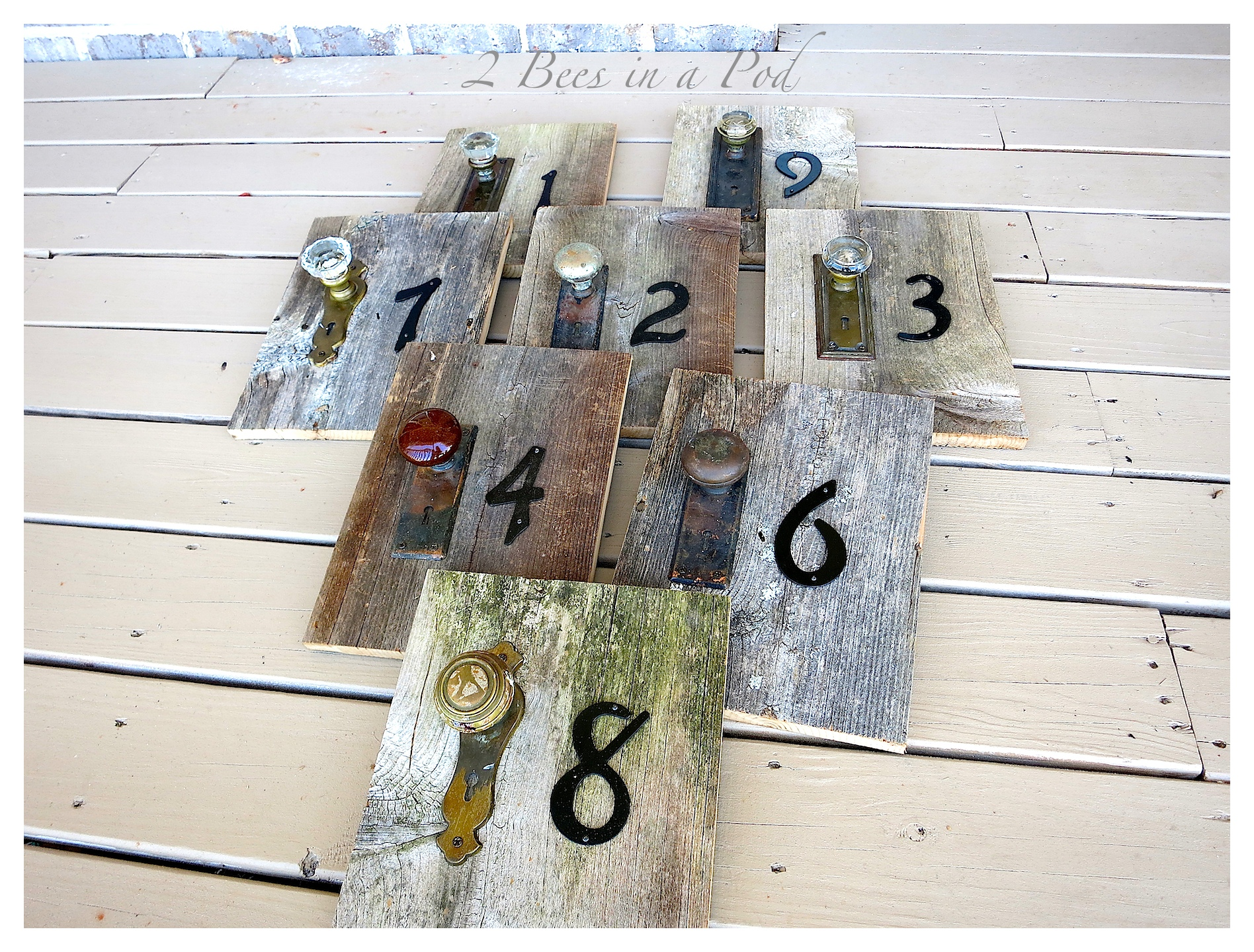 DIY Wedding Table numbers. We used old fencing, vintage door knobs, vintage escutcheons, and metal numbers to create unique table numbers for the reception.