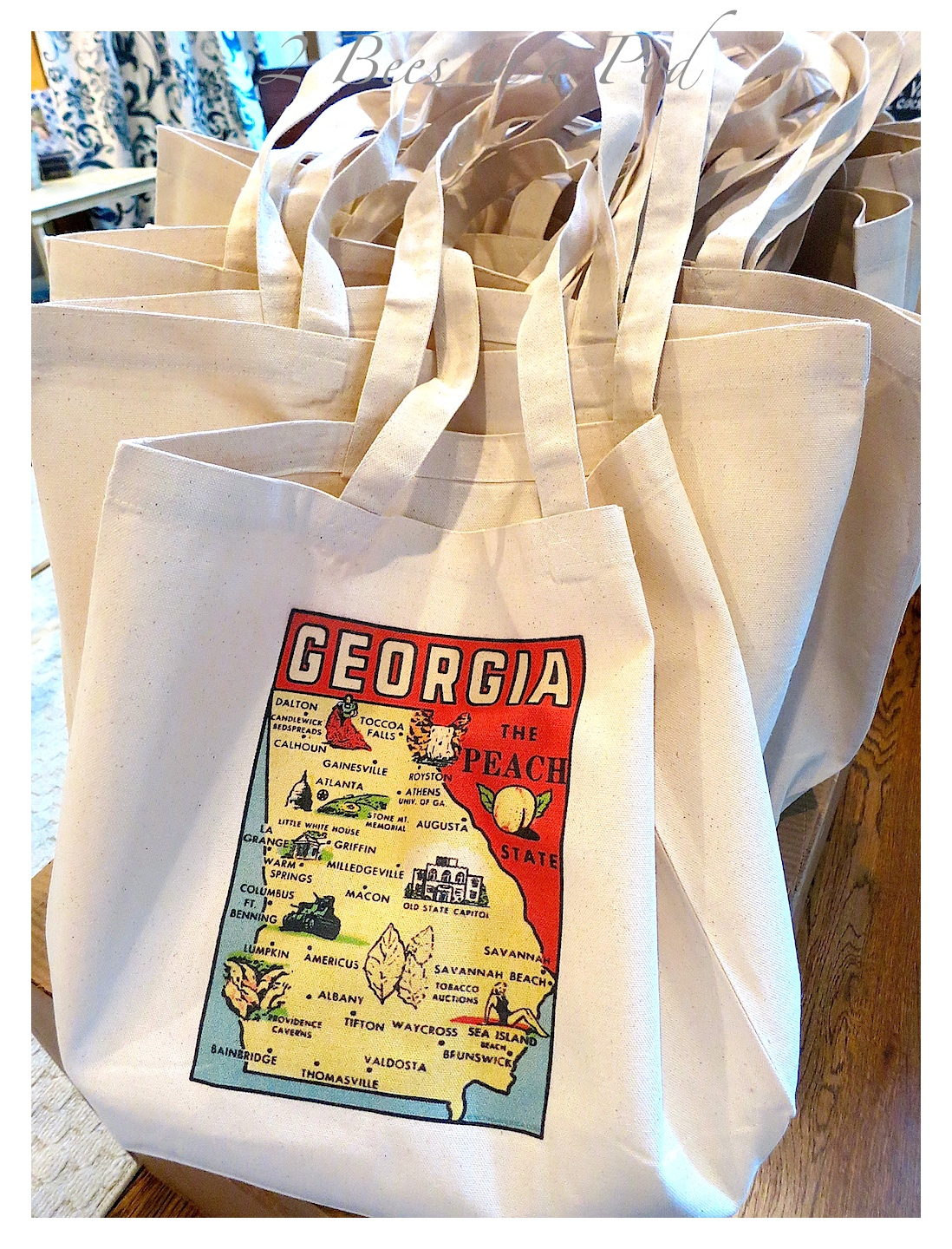 Wedding Guest Hotel Welcome Bags - We definitely wanted a vintage, Southern collection. Canvas bags with a vintage map of Georgia. Inside the bags: mimi Coke bottles, Jack Daniels minis, Nutty Bars, our favorite Nora Mill grits, Vintage Atlanta thank you postcard.