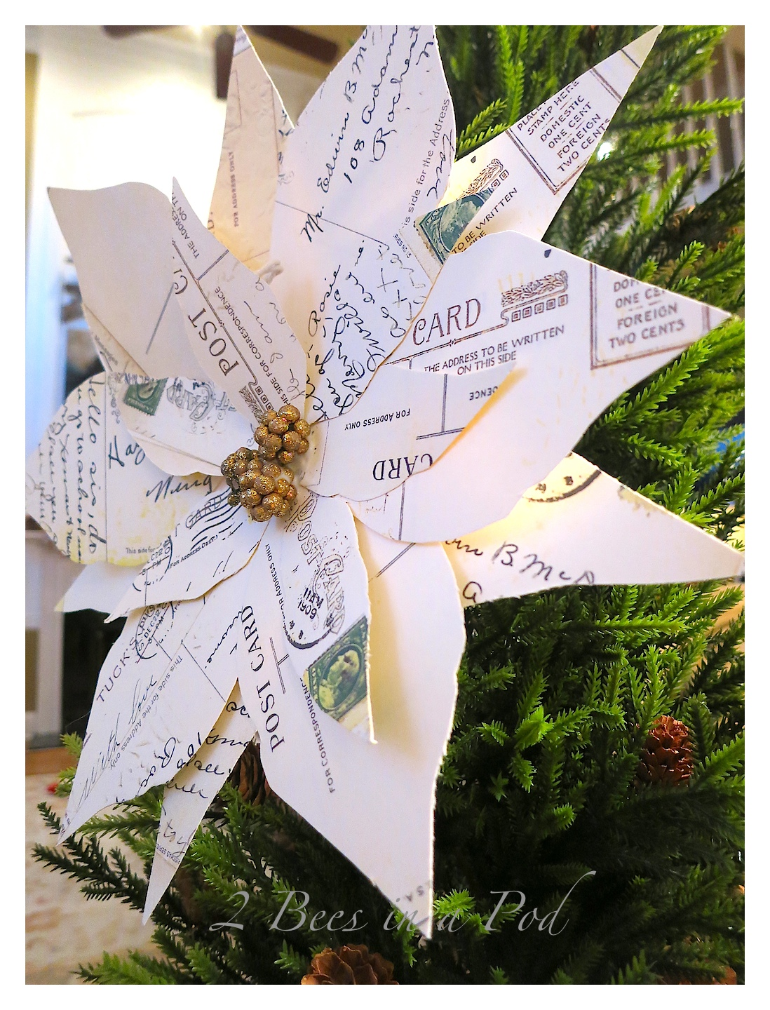 DIY Vintage Christmas Postcard Poinsettia. Simply photocopy the backs of vintage postcards. Cut out poinsettia leaf shapes and glue together.