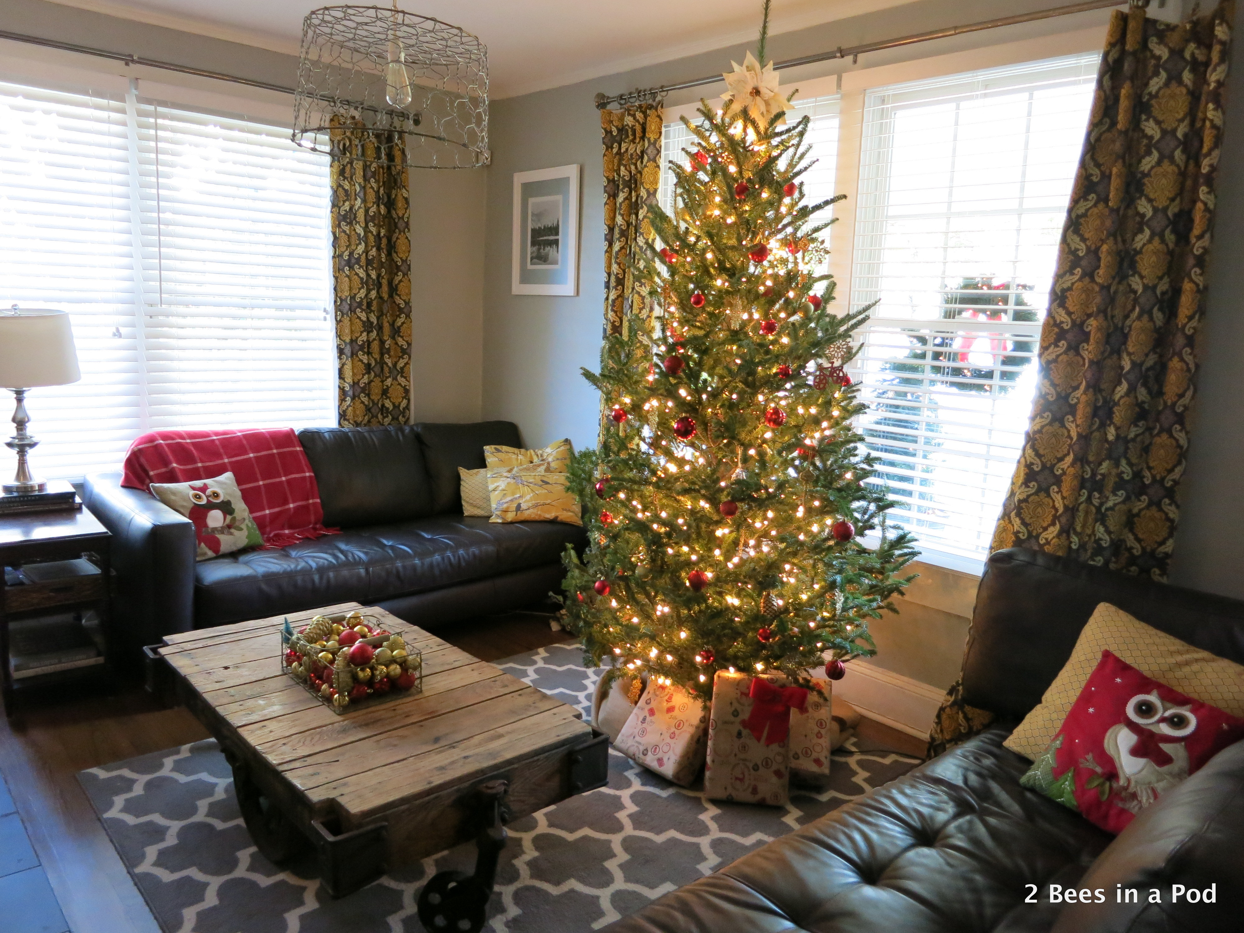 Christmas Home Tour. Christmas Tree with red & gold ornaments & DIY Poinsetta tree topper.  2