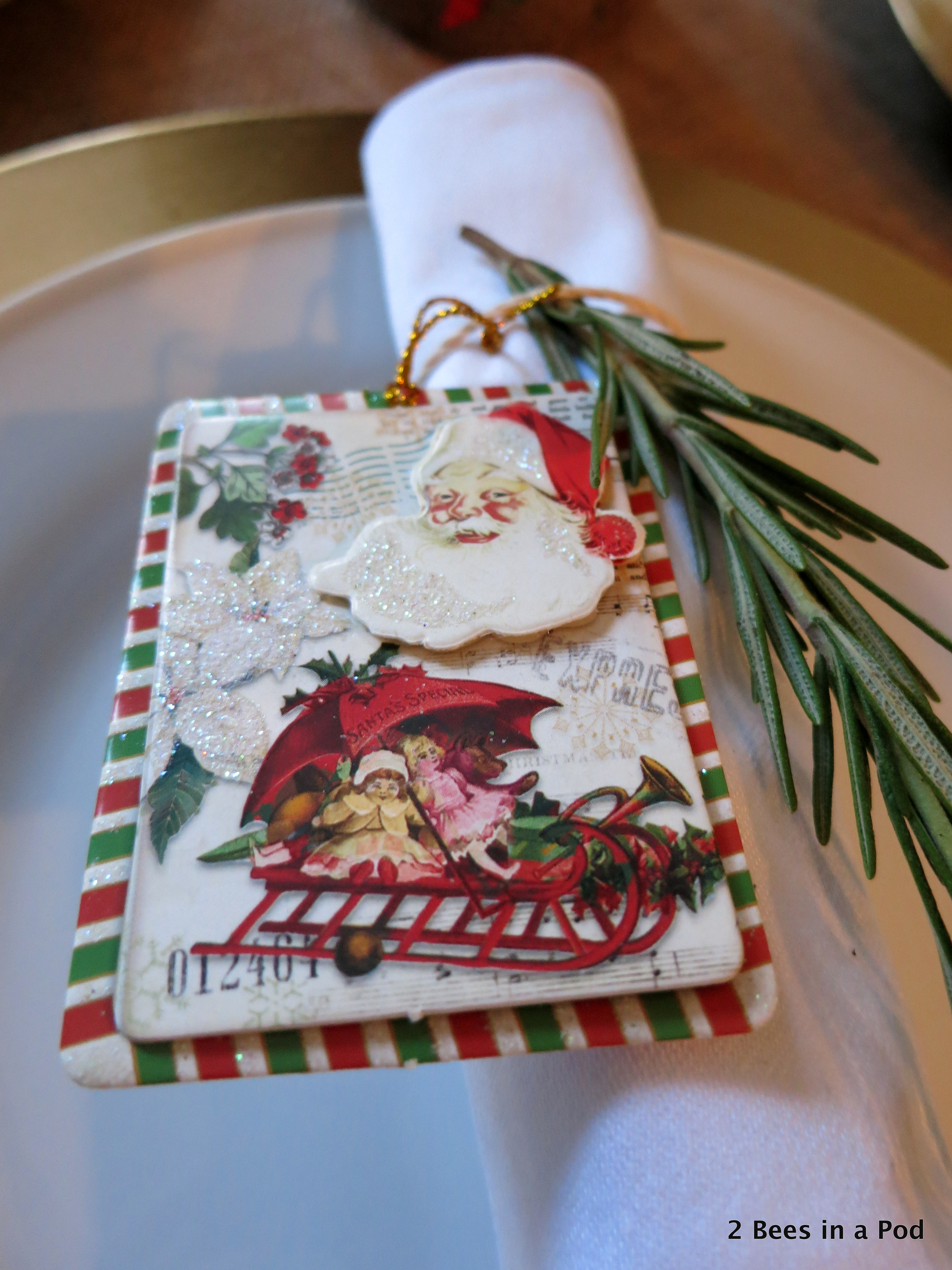 Christmas Home Tour. Dining Room Tablescape with burlap tablecloth and rosemary sprig with santa gift tag around white napkin 1