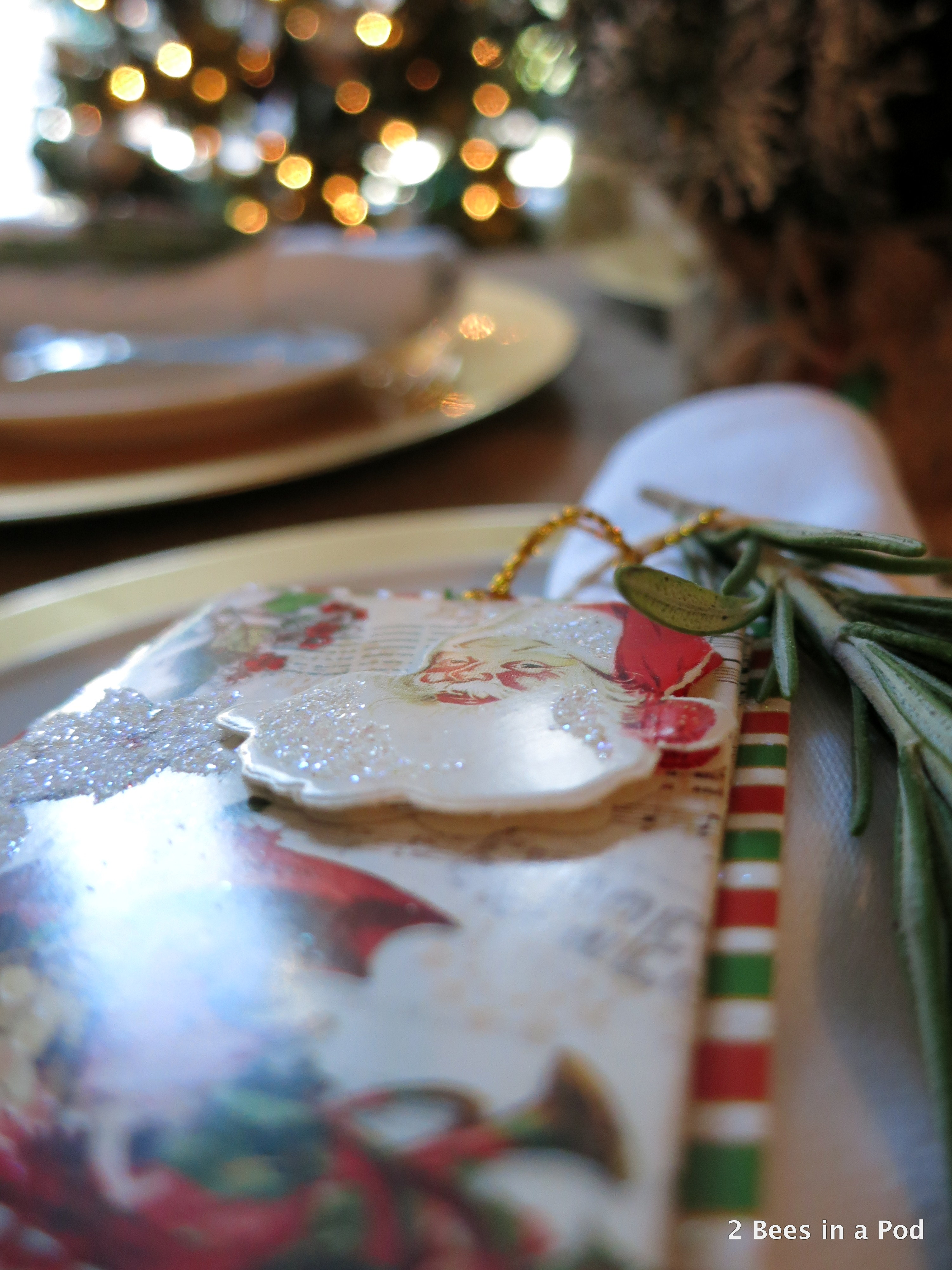 Christmas Home Tour. Dining Room Tablescape with burlap tablecloth and rosemary sprig with santa gift tag around white napkin 2