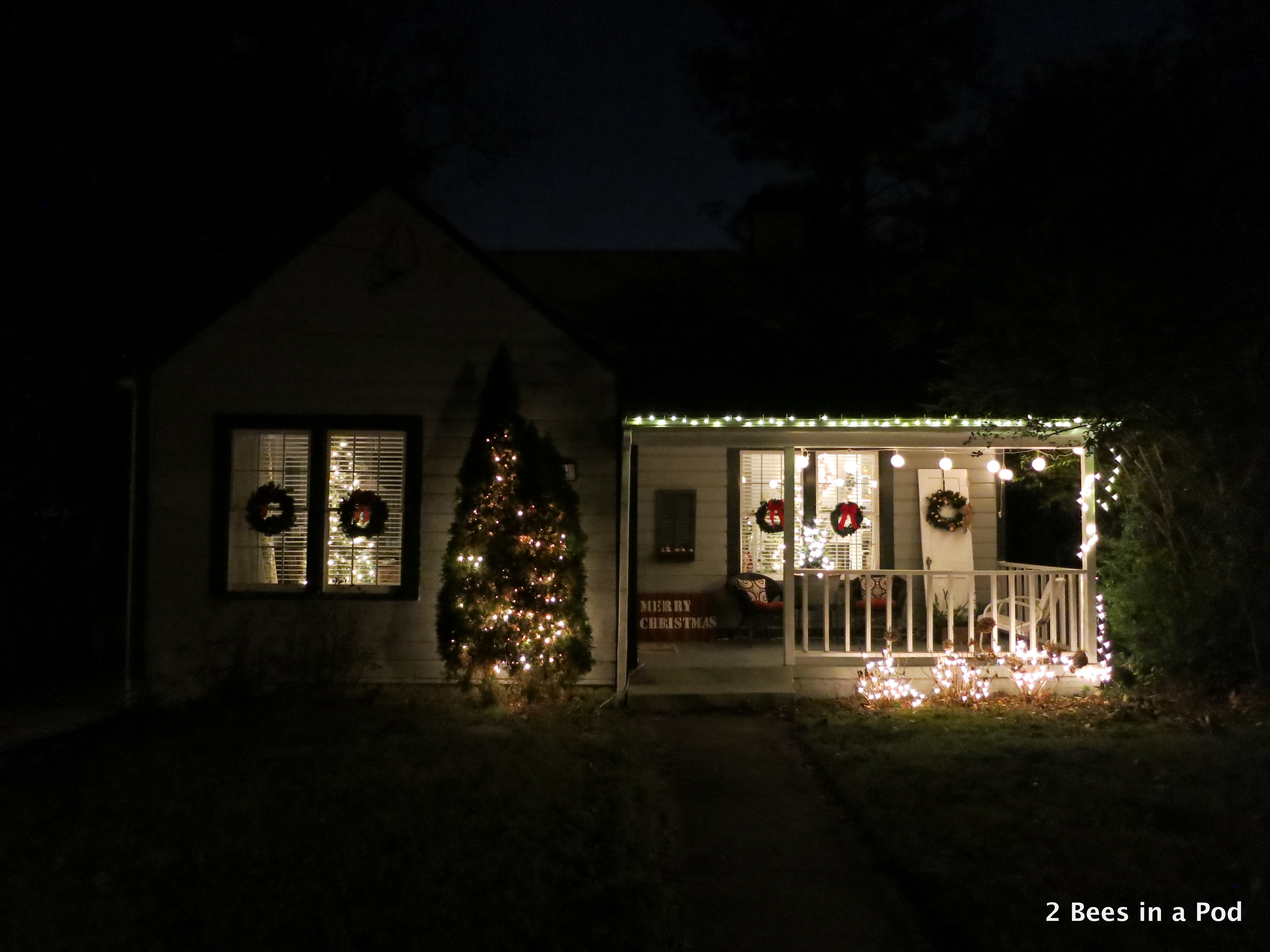 Christmas Home Tour. Exterior lit up with DIY stenciled Merry Christmas sign