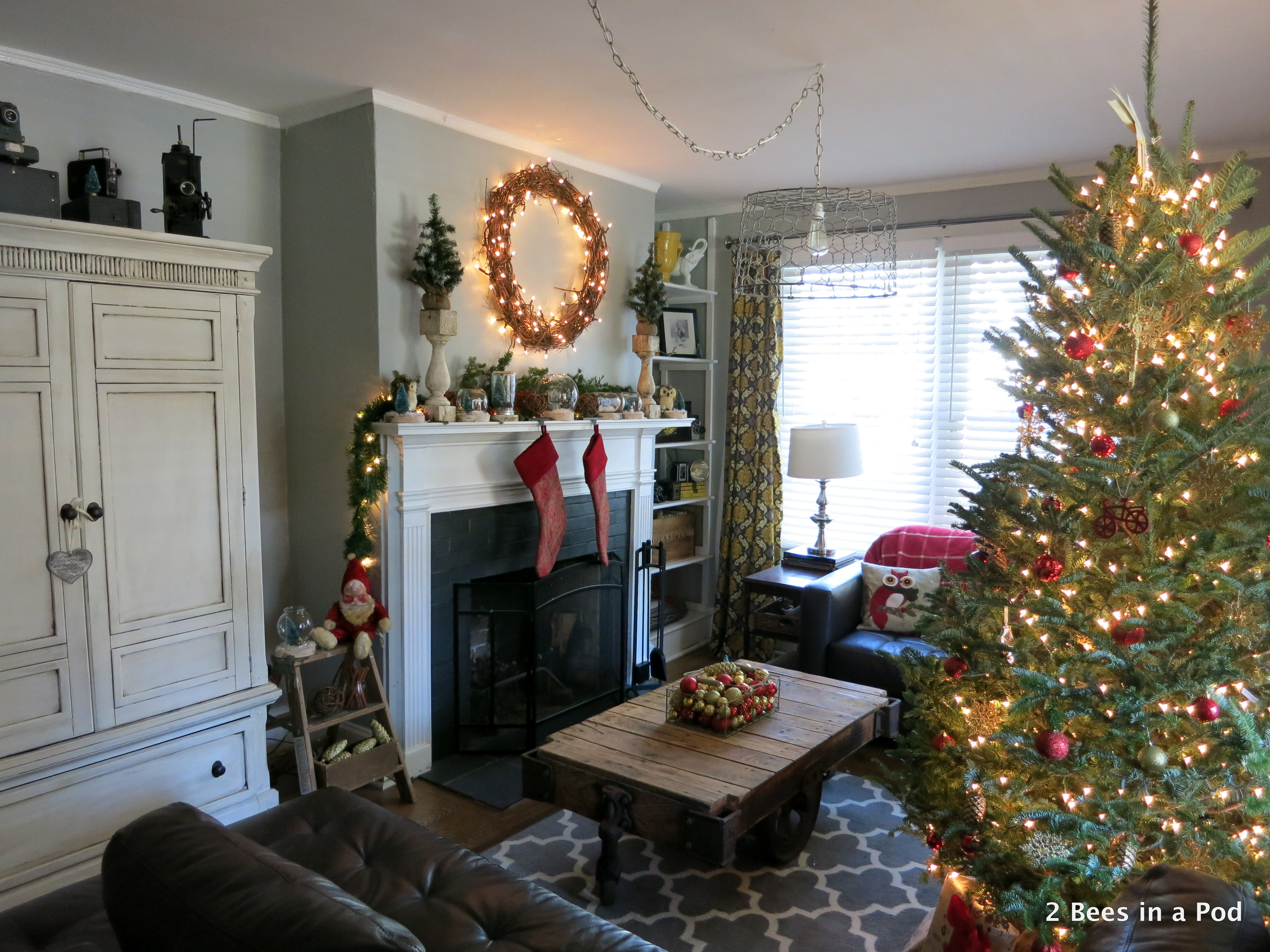 Christmas Home Tour. Living Room overview with Christmas Tree with red and gold ornaments, owl pillows, rustic mantel with woodland owls, grape wreath, and mason jar vignettes 1