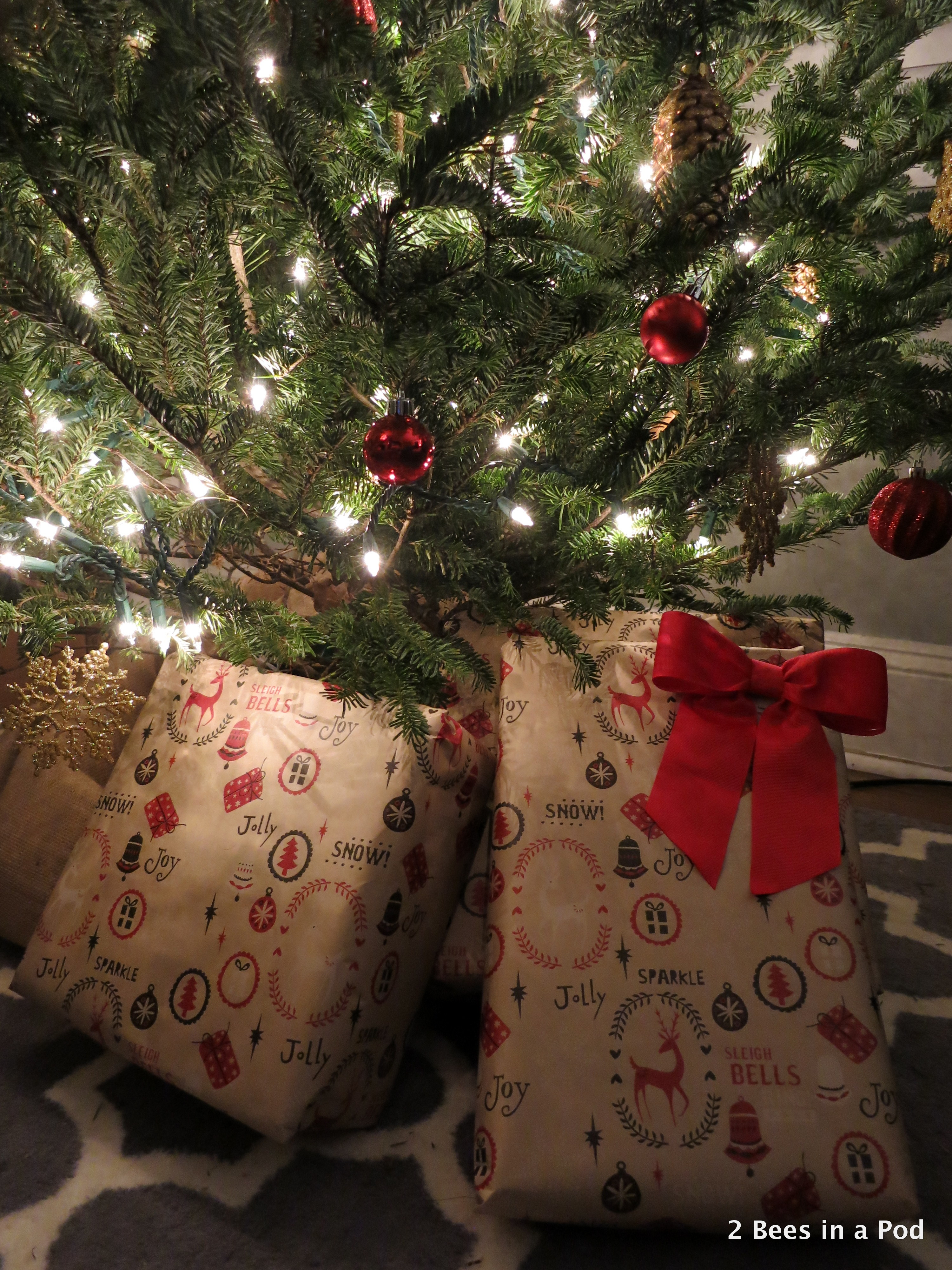 Christmas Home Tour. Presents under the tree with burlap tree skirt. Wrapping paper with deer from Dollar Store!