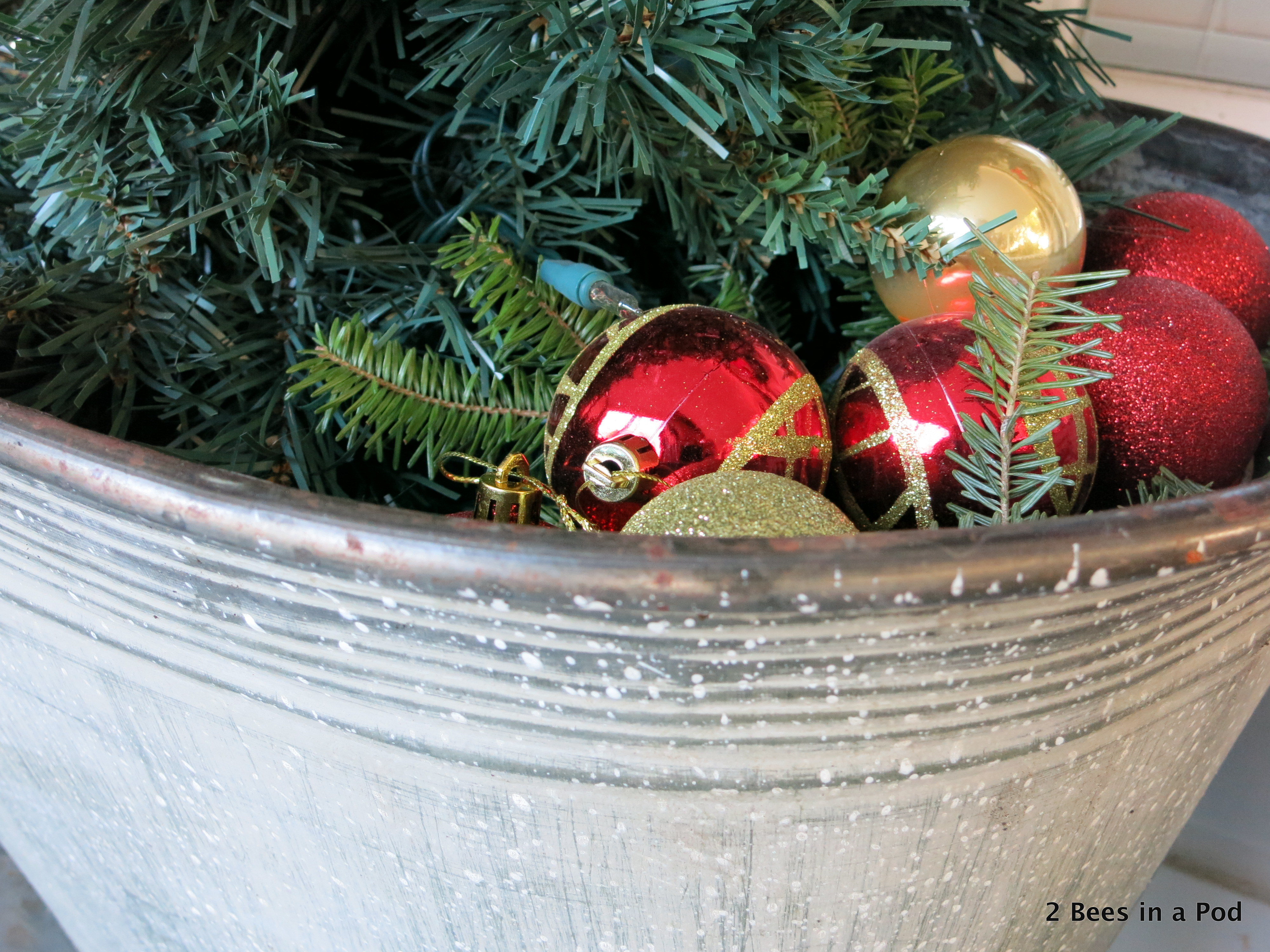 Christmas Home Tour. Tree in Glavanized Bucket on front porch with red & gold ornaments