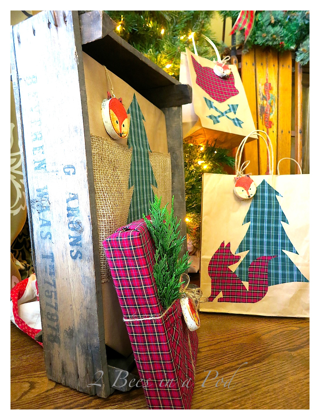 DIY Christmas Gift Wrap - Woodland Fox and Christmas Plaid. a hand painted wood slice fox as a gift tag. Bags Made from thrift store plaid shirts, Heat and Bond and cut out shapes ironed onto kraft bags. Also used a shirt as gift wrap and decorated the pocket :)