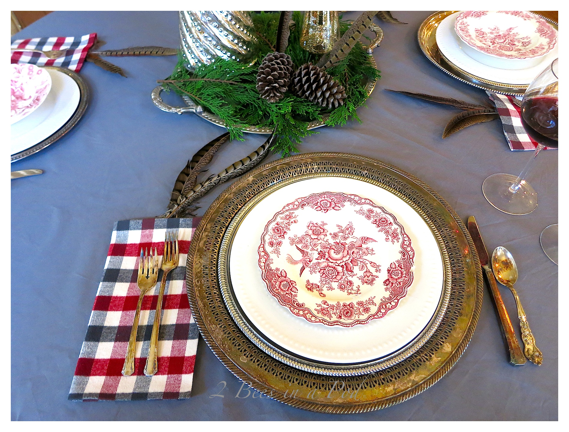 Casual Christmas Tablescape - using vintage silver, vintage red and white transfer ware, gray and red. Fresh cut greenery and mercury glass trees create a lovely centerpiece.