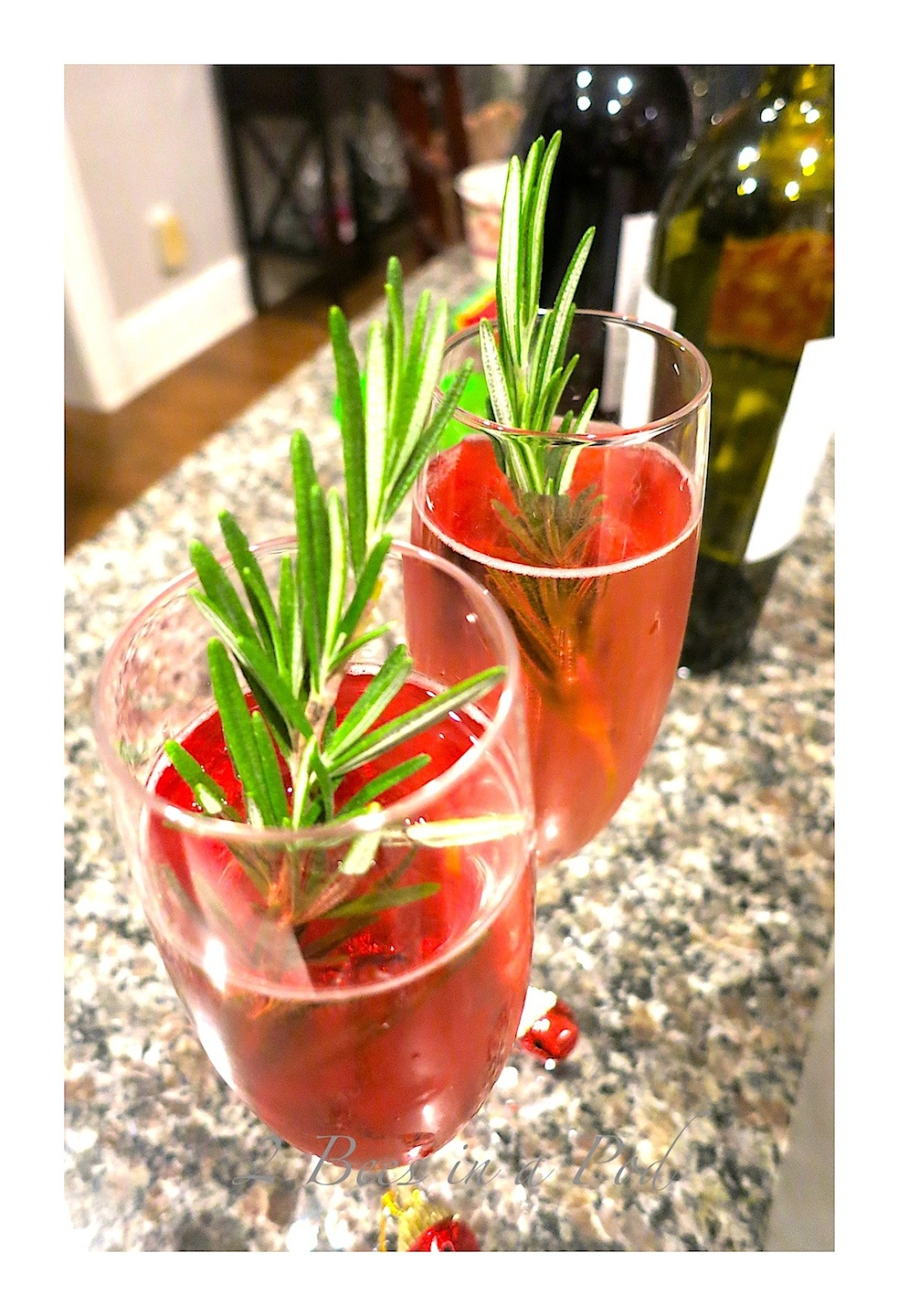 Poinsettia Cocktail - Prosecco, cranberry Juice and Rosemary garnish