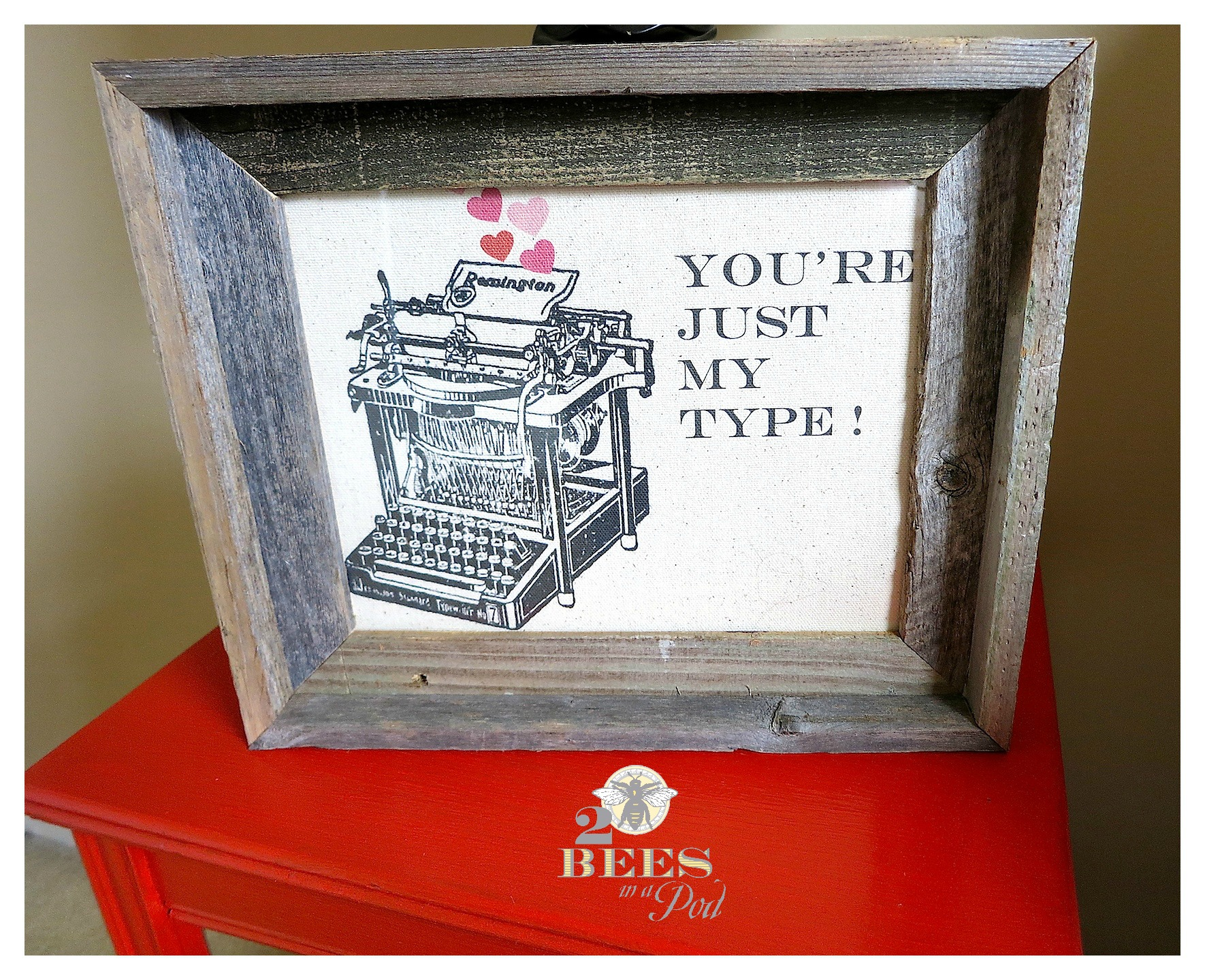 "Valentine message printed on fabric and placed in a rustic frame. Graphics of a vintage typewriter ""You're Just My Type"""