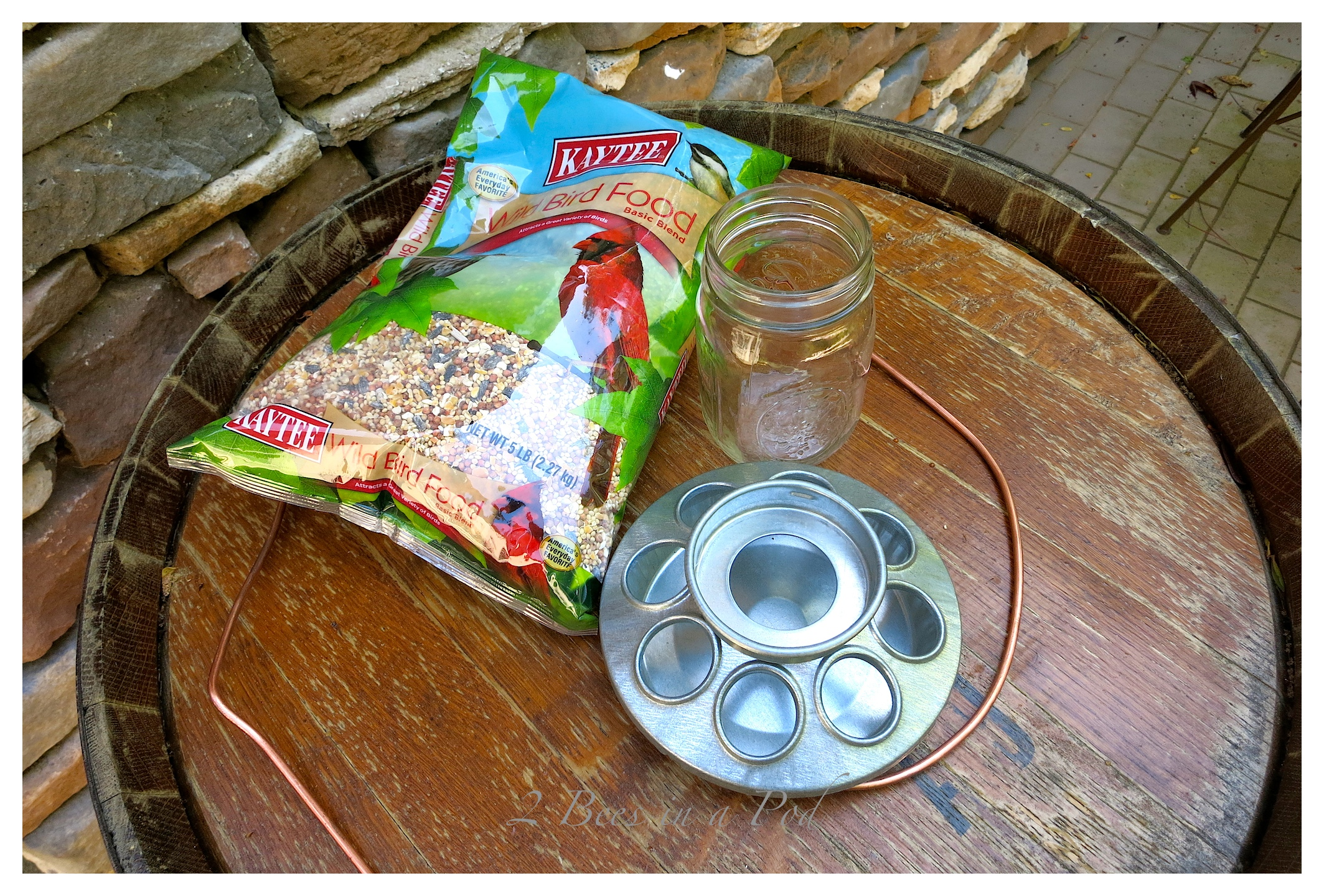 DIY Bird Feeder in Under 3 Minutes! Using a mason jar, chicken feeder and wire.