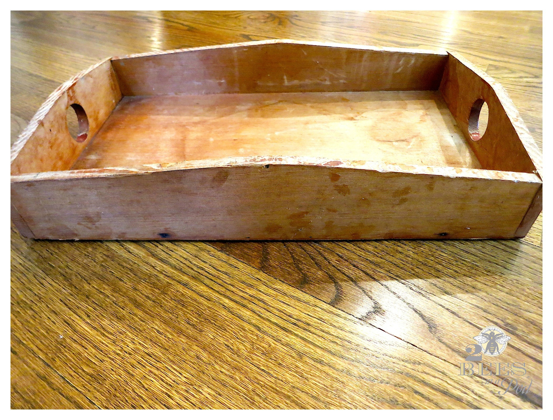 A thrift store wooden tray gets a makeover. A bit of whitewash and dark wax make it look beautiful!