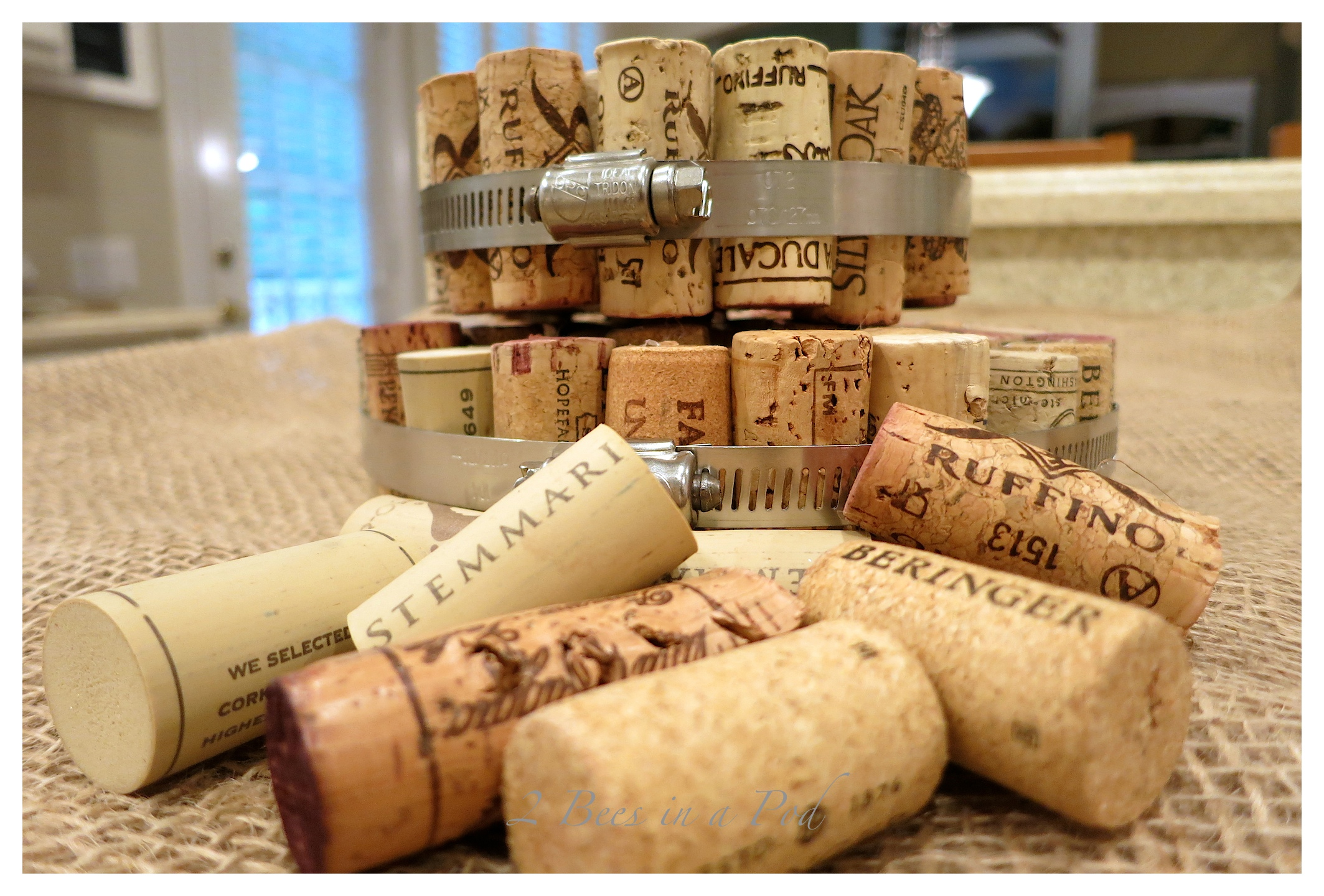 DIY Wine Cork Hot Pads - very easy and inexpensive project. All you need is wine corks and metal hardware clamps and a bit of hot glue.