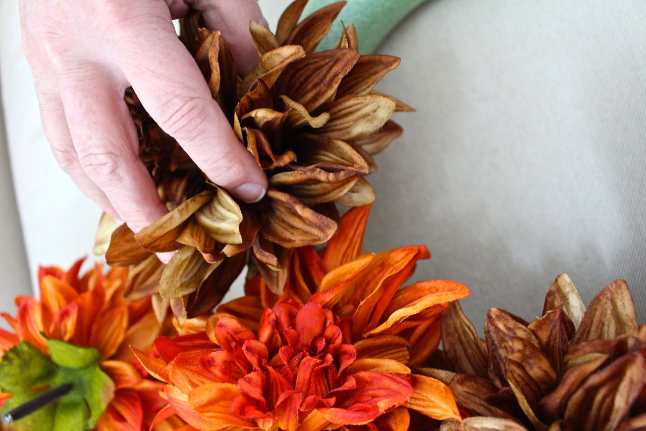 Work the floral stems into the wreath form. You'll want to wreath to look full.