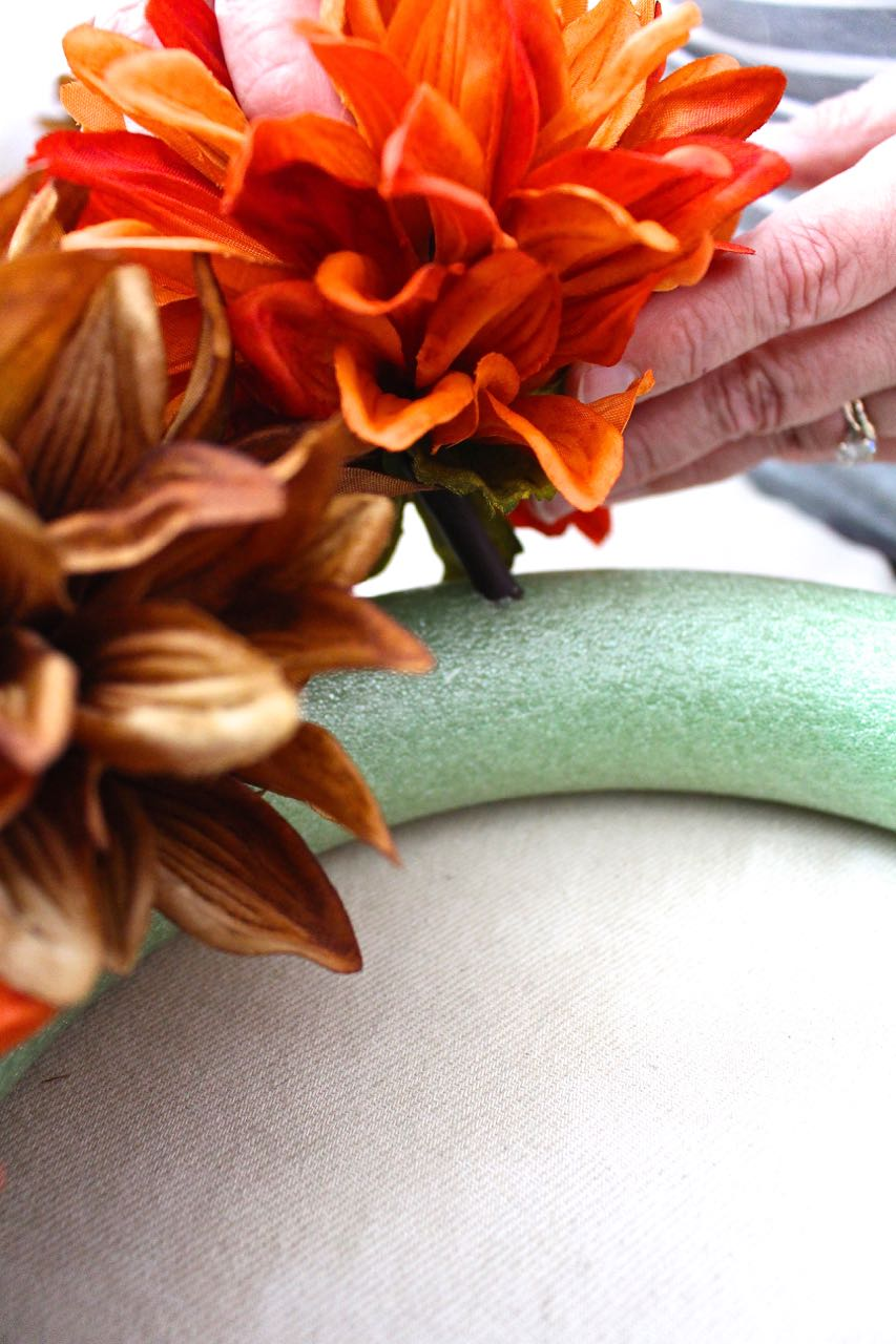 You don't need to make the floral stems flush with the foam. Just make sure they are secure.