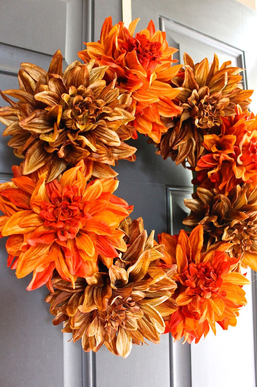 Using brown and orange faux flowers was perfect for the Fall wreath. The large floral stems make a statement.