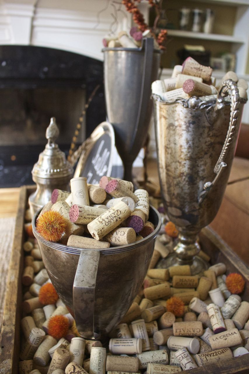 Fall Coffee Table decor. Vintage trohpies. Wine corks. feathers and natural elements on a wood tray