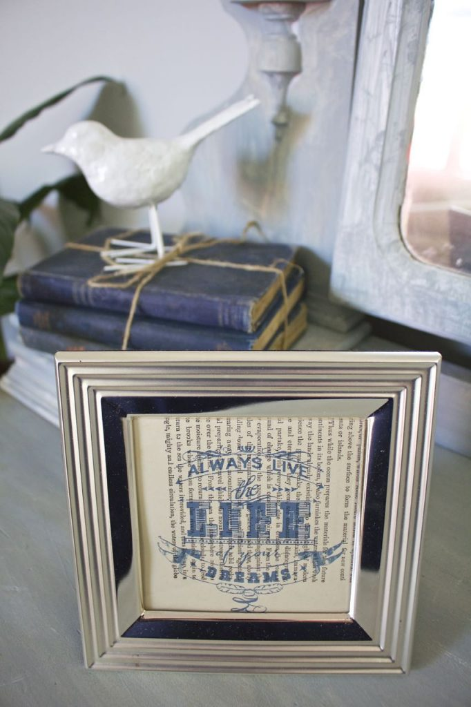 Summer Home Tour - Entry way. Vintage blue books and a framed quote printed on vintage book pages.