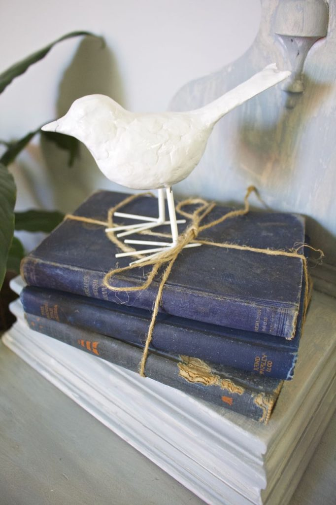 Summer Home Tour. Love to use vintage books in vignettes.