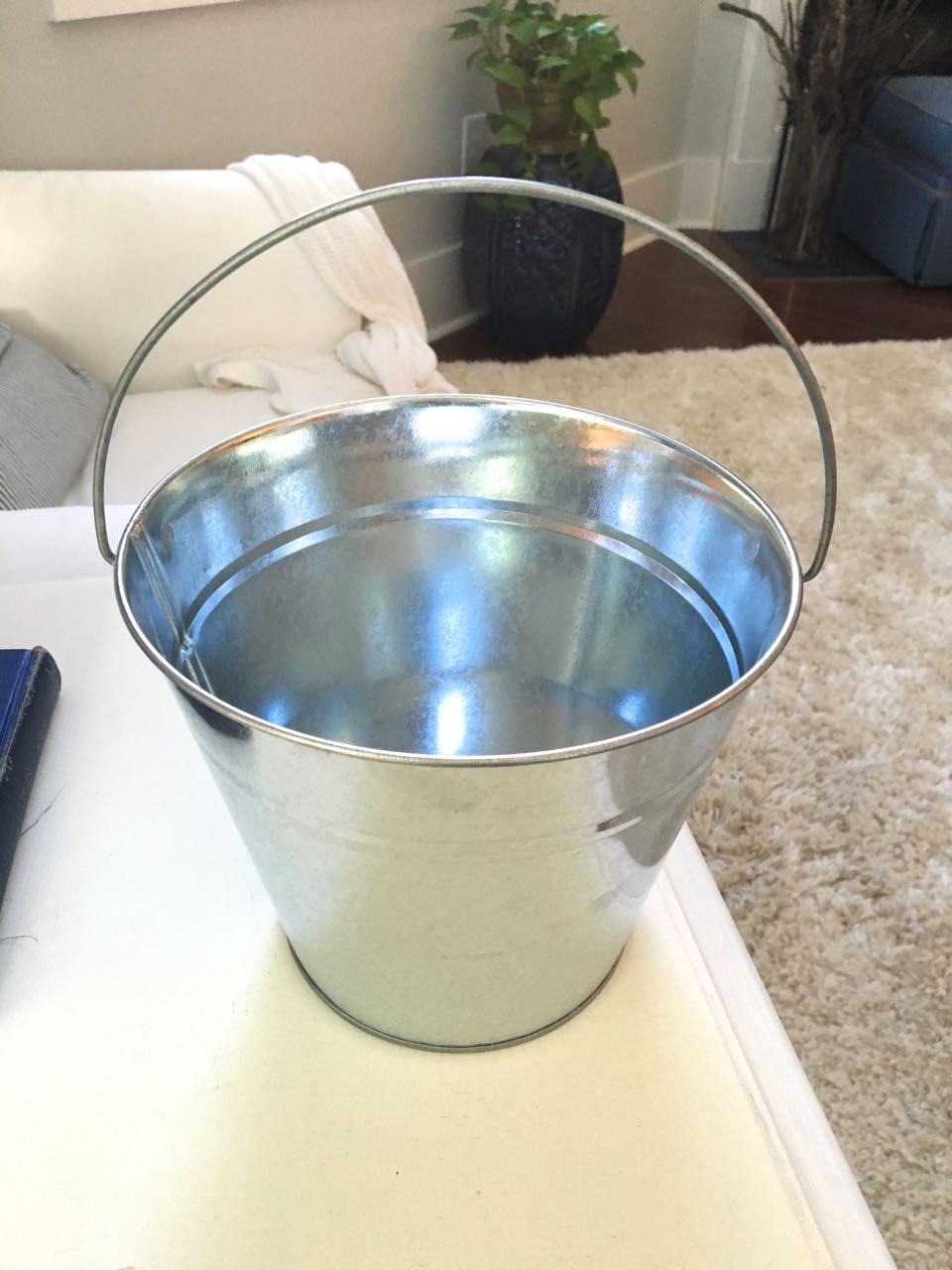 DIY Galvanized Bucket for Fall. Turn a dollar store, shiny bucket into a vintage-look galvanized bucket.
