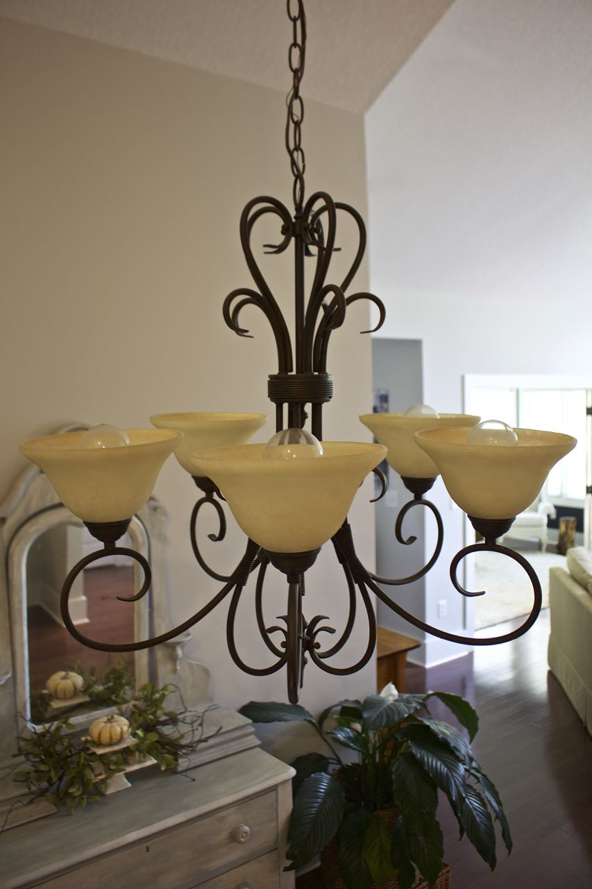 The Chandelier Globes Made Room Glow Yellow And Not In A Good Way I M Sure Were Designed To Make More Radiant