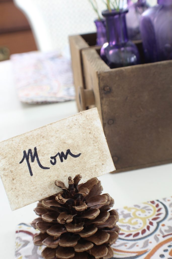 Fall home tour. Place card with pine cone.