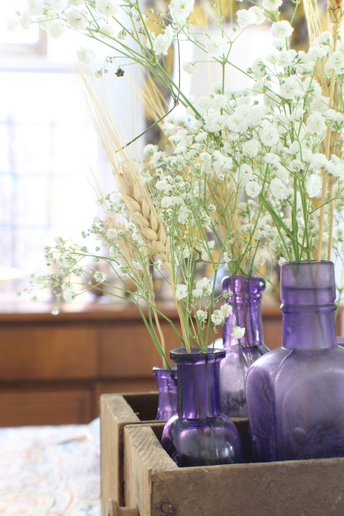 Fall home tour. Tablescape with vintage bottles.