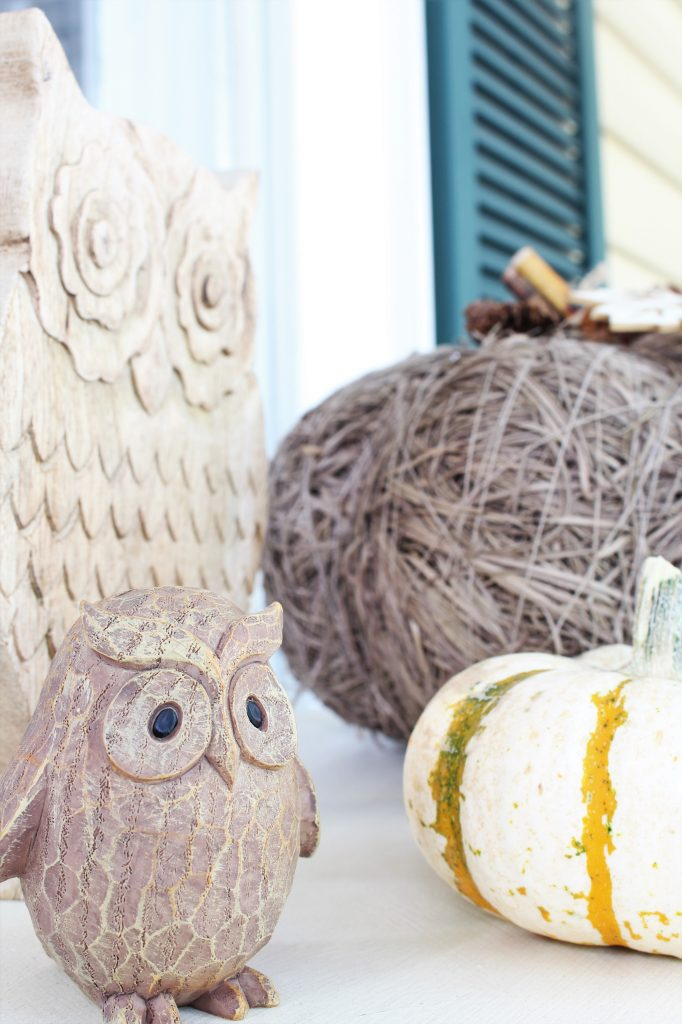 Fall front porch with wooden owls. Rustic Pumpkin.