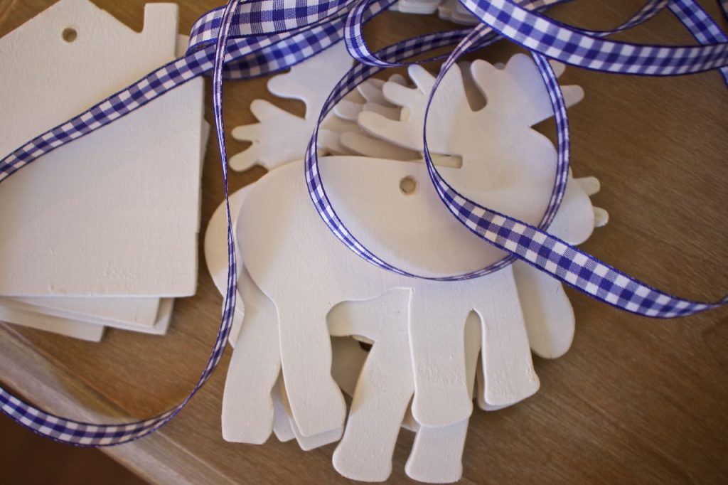 wooden-ornaments-are-all-painted-and-ready-to-be-hung