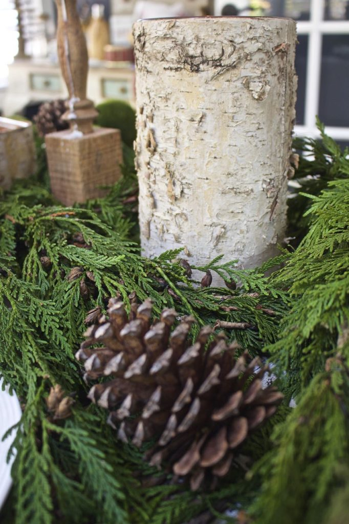 rustic-christmas-tablescape-table-christmas-decor-greenery-evergreen-pinecones-and-birch-candles