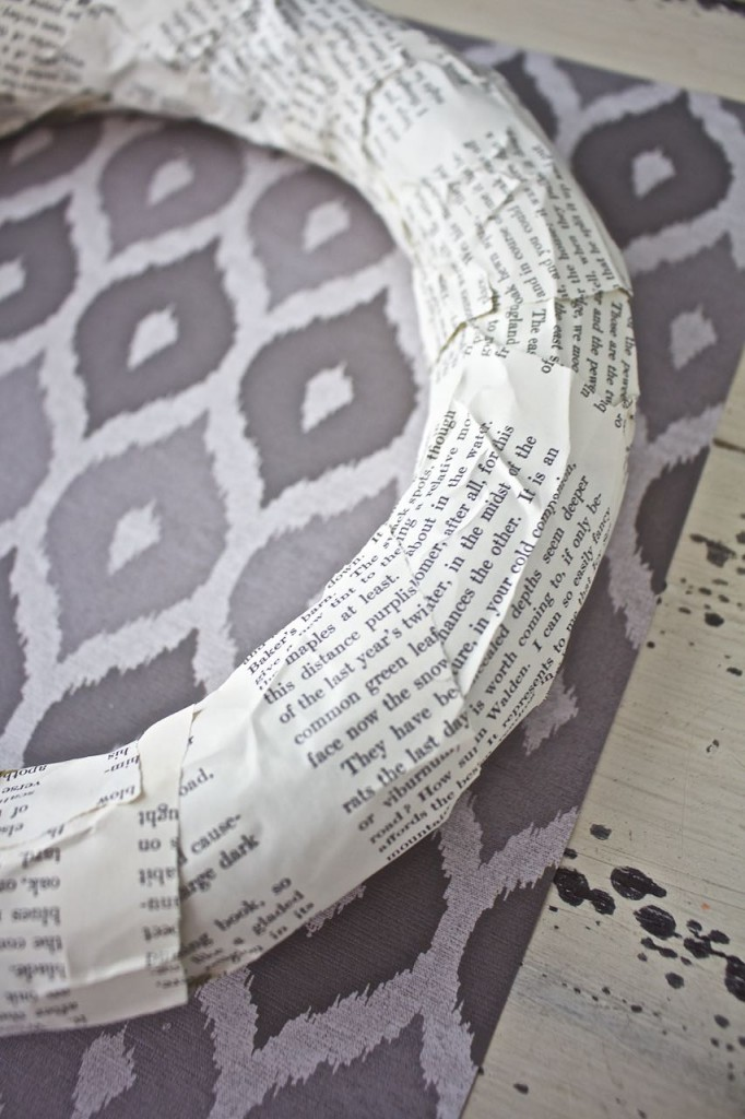 Book page magnolia wreath. Wrap the strips of book pages to the wreath form using hot glue.