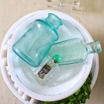 Farmhouse Tiered Bowl. Vintage aqua Bottles.