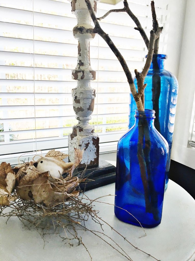 Winter Home Tour. Vintage cobalt blue glass and nest found in nature.