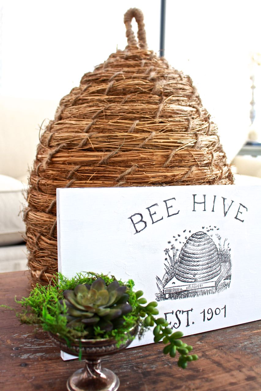 DIY Bee Hive Sign. A thrift store print gets a painted makeover