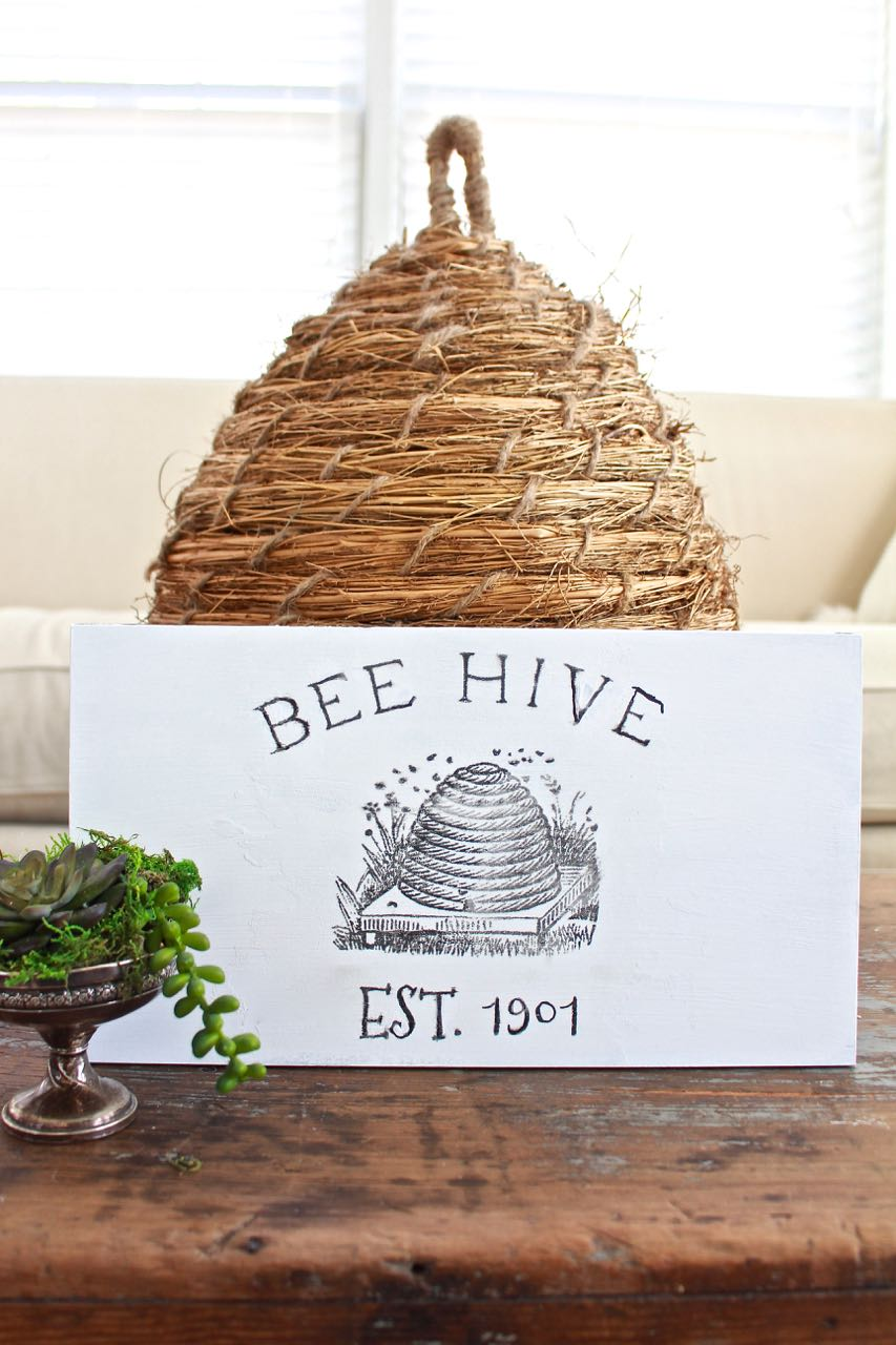 DIY Bee Hive Sign. DIY bee hive sign looks great on the vintage table.