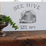 DIY Sign with Iron On Graphics - Thrift Store Upcycle. DIY Bee Hive Sign. The background was painted in Pure White chalk paint by Annie Sloan