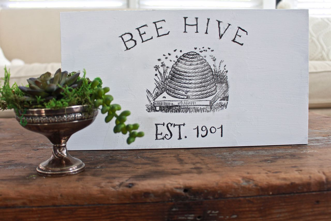 DIY Bee Hive Sign. The background was painted in Pure White chalk paint by Annie Sloan
