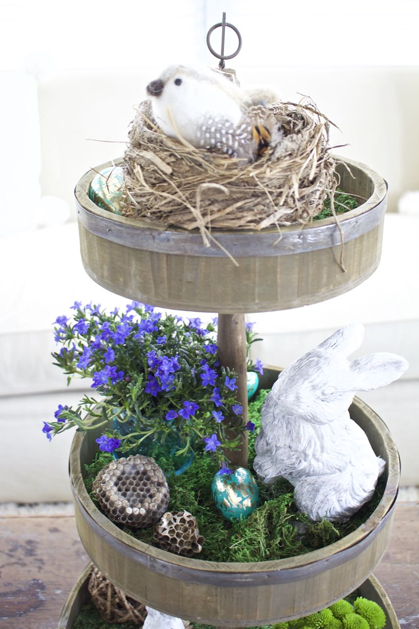 Pretty Spring decor with bunnies, flowers and moss