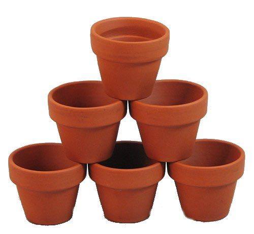 Citronella candles in mini clay pots