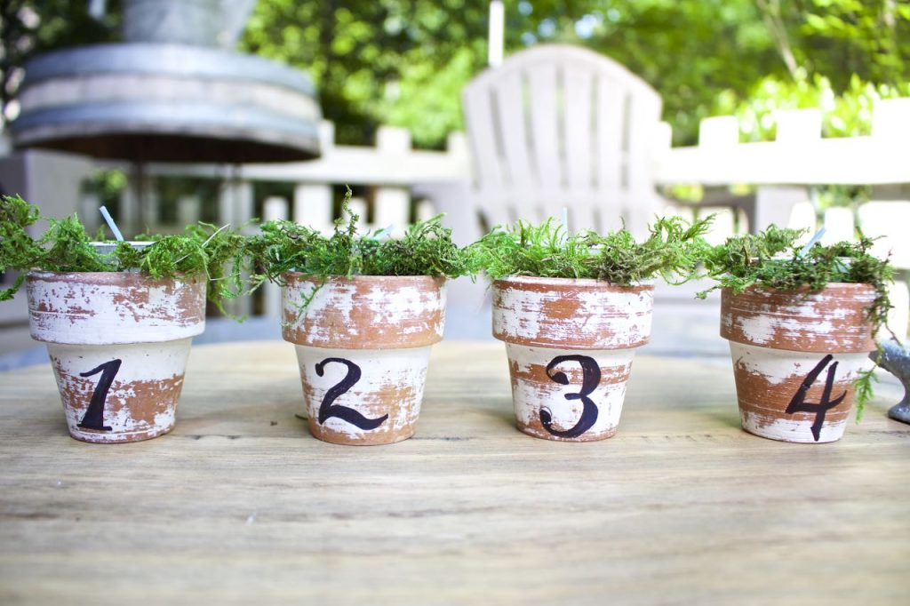 Citronella Candles in Mini Clay Pots. French script numbers on mini clay pots.