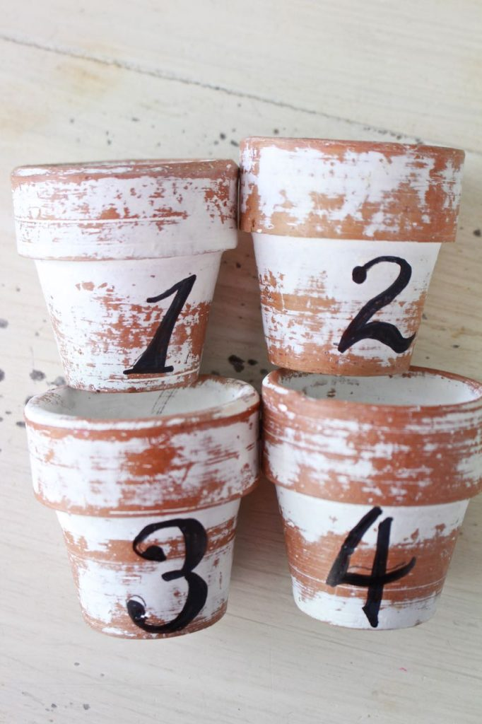 Citronella Candles in Mini Clay Pots. The mini clay pots are ready for moss and a citronella tea light.