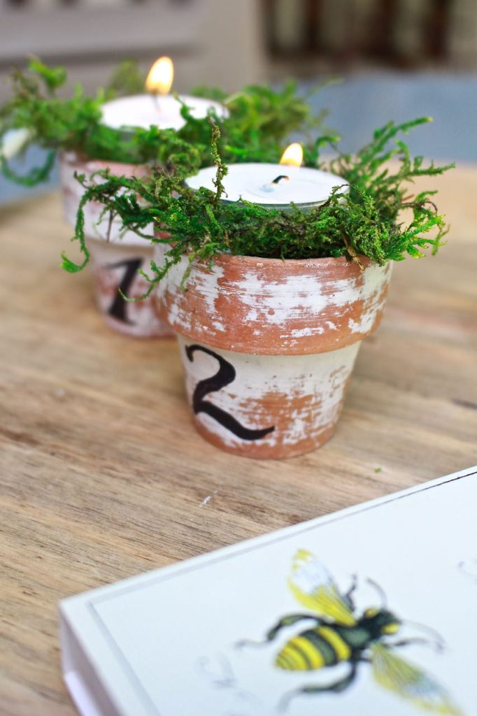 Citronella Candles in Mini Terra Cotta Clay Pots. Mini terra cotta pots, distressed and numbered in French script.