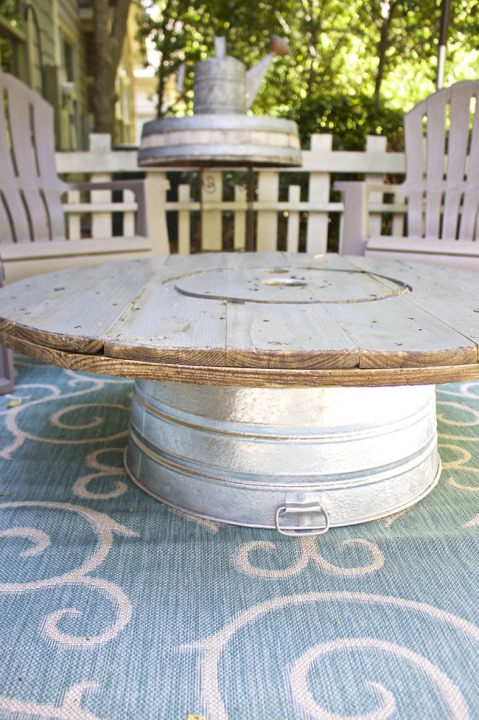 Wire Spool DIY Coffee Table. A galanized tub is used as a secure base for the spool top.
