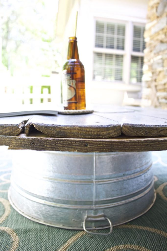 Wire Spool DIY Coffee Table. Galvanized tub is the base for the wire spool table