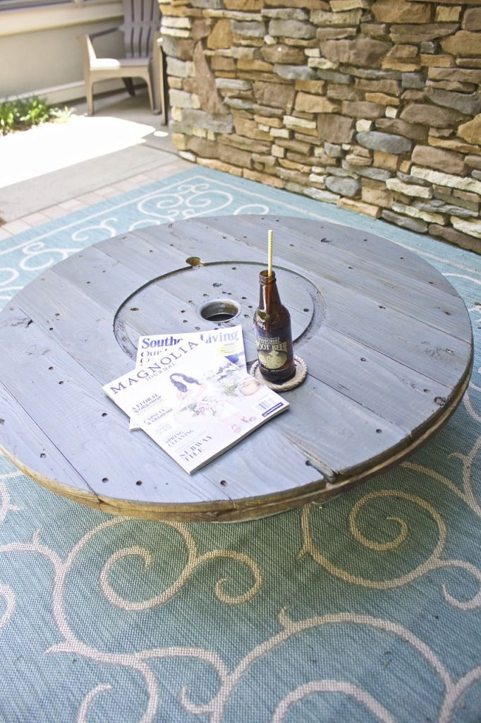 Wire Spool DIY Coffee Table. Wire spool table on the front porch